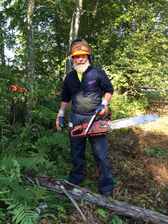 Dr. David Beaufait with chainsaw